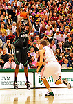 13 February 2011: Binghamton University Bearcat forward Moussa Camara, a Senior from  Paris, France, in action against the University of Vermont Catamounts at Patrick Gymnasium in Burlington, Vermont. The Catamounts came from behind to defeat the Bearcats 60-51 in their America East matchup. The Cats took part in the National Pink Zone Breast Cancer Awareness Program by wearing special white jerseys with pink trim. The jerseys were auctioned off following the game with proceeds going to the Vermont Cancer Center. Mandatory Credit: Ed Wolfstein Photo