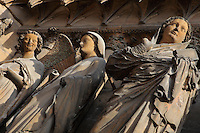 Low angle view of Angel Gabriel, Virgin Mary, her cousin Elysabeth, annunciation group, right jamb statues of the central portal of the western facade of Notre-Dame de Reims (Our Lady of Rheims), pictured on February 15, 2009, 13th - 15th century, Roman Catholic Cathedral where the kings of France were crowned, Reims, Champagne-Ardenne, France.