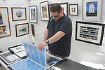 Justin Cissell looks at art at the Double Decker Arts Festival in Oxford, Miss. on Sunday, April 25, 2010.