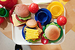 """September 14, 2011. Raleigh, NC. . Fake food in the """"restaurant"""" in the class.. Project Enlightenment, a public pre-kindergarten program for at risk children, has been threatened with closure due to state wide budget cuts.."""