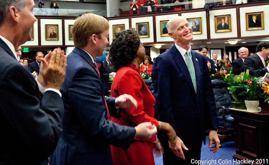TALLAHASSEE, FLA. 3/8/11-OPENINGDAY030811 CH-Gov. Rick Scott, right, is recognized during the opening day of the 2011 legislative session Tuesday at the Capitol in Tallahassee. Joining him are Chief Financial Officer Jeff Atwater, left, Agriculture Commissioner Adam Putnam and Lt. Gov. Jennifer Carroll..COLIN HACKLEY PHOTO