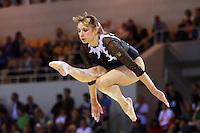 Oct 17, 2006; Aarhus, Denmark;  Maryna Proskurina of Ukraine performs cossack jump on balance beam during women's gymnastics team competition at 2006 World Championships Artistic Gymnastics.<br />
