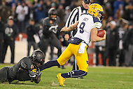 Baltimore, MD - December 10, 2016: Navy Midshipmen quarterback Zach Abey (9) gets sacked by a Army Black Knights defender during game between Army and Navy at  M&T Bank Stadium in Baltimore, MD.   (Photo by Elliott Brown/Media Images International)