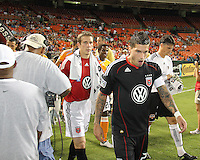 Santino Quaranta #25 of D.C. United  leads the team onto the field during an MLS match against the Houston Dynamo at RFK Stadium in Washington D.C. on September  25 2010.Houston won 3-1.