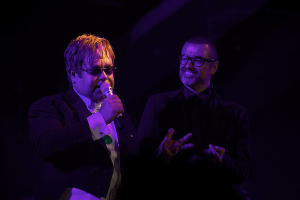 Elton John performs with George Michael during his White Tie and Tiara Ball