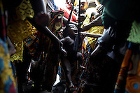 Children are weighed at MSF's mobile clinic before being testing for Malaria, in the remote village of Kashuga, North Kivu, DRC.