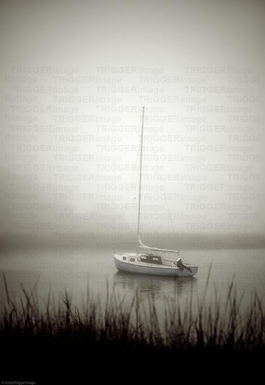 Sailboat anchored in a quiet harbor, Cape Cod, Massachusetts, USA
