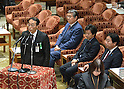 February 3, 2012, Tokyo, Japan - Ro Manabe, chief of the Defense Ministrys Okinawa Defense Bureau, testifies during a Diet lower house Budget Committee meeting in Tokyo on Friday, February 3, 2012. Seated in the background are, from left: Defense Minister Naoki Tanaka; Finance Minister Jun Azuki and Prime Minister Yoshihiko Noda. Manabe has come under suspicion of tampering with the upcoming mayoral election in Ginowan, Okinawa Prefecture, where the U.S. Marine Corps Futenma Air Station is located. Manabe might not have violated any law by reportedly holding lectureson the local elections to his subordinates, according to the media reports. Defense Minister Tanaka, however, has no other choice but to sack him to lessen the damage to the government of Prime Minister Noda. (Photo by Natsuki Sakai/AFLO) AYF -mis-