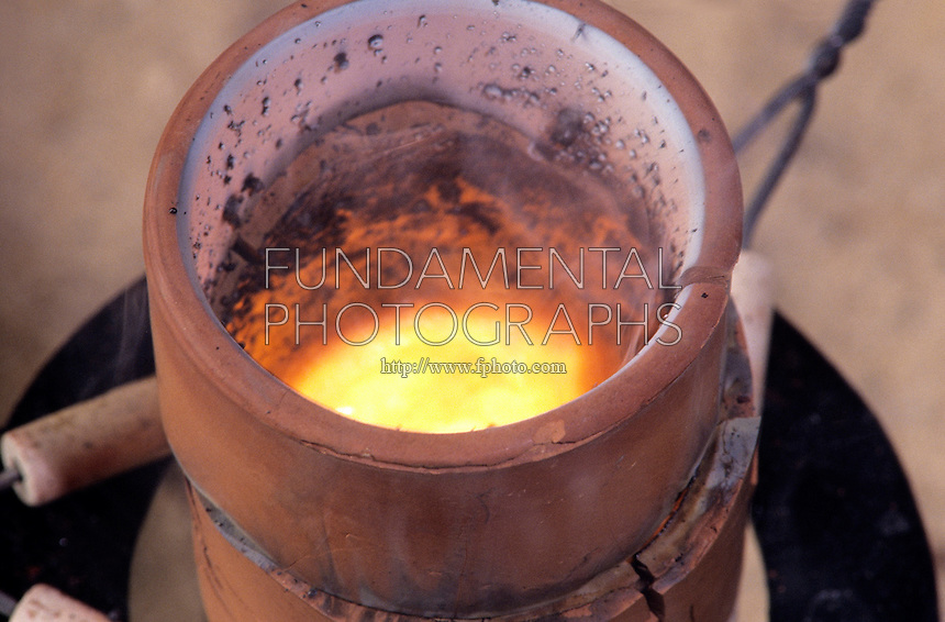 THERMITE PROCESS: REDUCTION OF Fe2O BY ALUMINUM<br /> Exothermic Reaction Produces Molten Iron.<br /> Produces small quantities of molten iron for special purposes like the repair of railway lines. Aluminum is reactive enough to reduce less reactive metal oxides to the metal. Strongly exothermic reaction started by adding glycerine to the mix w/KMNO4.