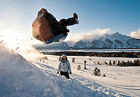 "NEWS&GUIDE PHOTO / PRICE CHAMBERS.Andrew Klas flies off a kicker in Grand Teton National Park on Saturday as friend Kelly Brenn watches from below. The two tourists are on vacation with other friends from Greenville, S.C. ""We came to snowboard but we're staying out of the backcountry,"" Klas said. ""The mountains are pretty awesome."""