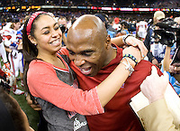 Louisville head coach Charlie Strong hugs his daughter after winning 79th Sugar Bowl game against Florida at Mercedes-Benz Superdome in New Orleans, Louisiana on January 2nd, 2013.   Louisville Cardinals defeated Florida Gators, 33-23.