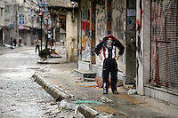 A boy covers his head and part of his face in shock following an assault by government forces in their attempt to retake the area from the Free Syrian army.Protests against the ruling Baathist regime of Bashar al-Assad erupted in March 2011. Although they were initially peaceful,  they were violently repressed by the Syrian army and police. In response to being ordered to shoot unarmed civilians, large numbers of men deserted the army and formed the Free Syrian Army. The protest movement has now turned into an armed uprising with clashes between the regular army and the Free Syrian Army taking place in early 2012..