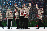 Greg Westlake waves to the fans in BC Place as Team Canada walks in during the opening ceremony of the 2010 Paralympic Games in Vancouver.