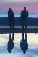 A couple amid the sunset at Santa Monica Beach on Saturday, January 2, 2010.