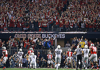 The crowd celebrates as Ohio State Buckeyes running back Ezekiel Elliott (15) scores a touchdown during the first quarter the College Football Playoff National Championship at AT&T Stadium in Arlington, TX on Monday, January 12, 2015. (Columbus Dispatch photo by Jonathan Quilter)