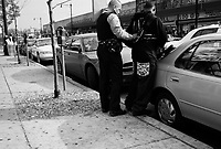Chicago, Illinois, Nov 2, 2008..Police officer arrests a suspect. Westside Chicago is one of the poorest and most violent part of the city:drugs, alcool, traffics of all kinds show up everywhere.
