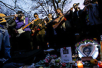 Fans of John Lennon gather around the 'Strawberry Fields'  in Central Park during the 35-year anniversary of his death in New York December 8, 2015. The death of John Lennon still reverberates as a defining moment for a generation and for the music world. Police said the shooting occurred outside the Dakota, the century-old luxury apartment house where Lennon and his wife, Yoko Ono, lived. It is across the street from Central Park. Kena Betancur/VIEWpress.