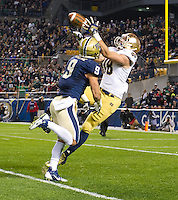 Tight end Ben Koyack (18) catches a pass over Pittsburgh Panthers safety Ray Vinopal (9) in the second quarter. The play appeared to result in an Irish touchdown but Koyak was ruled down in a review of the play.