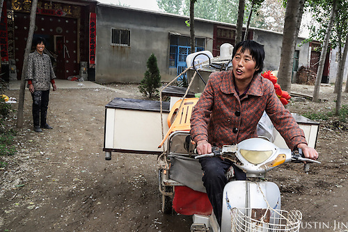 Chen Hua, 50, moves out of a village accommodation for her new urban home in northeastern China.<br /> <br /> Her former village house was bulldozed by the government three years ago to make way for high-rise development. <br /> <br /> In the four years between her rural home being razed and the completion of her new city apartment, she and her family lived in temporary village housing such as this one. <br /> <br /> China is pushing ahead with a dramatic, history-making plan to move 100 million rural residents into towns and cities over the next six years &mdash; but without a clear idea of how to pay for the gargantuan undertaking or whether the farmers involved want to move.<br />
