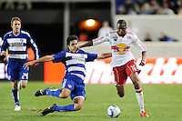 George John (14) of FC Dallas goes for a tackle on Macoumba Kandji (10) of the New York Red Bulls. The New York Red Bulls defeated FC Dallas 2-1 during a Major League Soccer (MLS) match at Red Bull Arena in Harrison, NJ, on April 17, 2010.