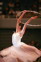 Anna Bessonova of Ukraine turns pirouette with hoop during gala exhibition at 2006 Aeon Cup Worldwide Club Championships in rhythmic gymnastics on November19, 2006.<br />