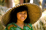 Indonesia: Lombok Island, woman in straw hat.  Photo: baliin105.Photo copyright Lee Foster, 510/549-2202, lee@fostertravel.com, www.fostertravel.com