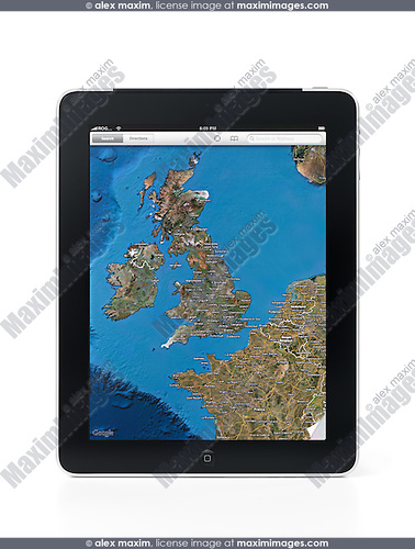 Apple iPad 3G tablet with Google maps displaying United Kingdom and a part of Europe on its screen. Isolated on white background with clipping path