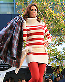 Tommy Hilfiger fashion show, model is wearing a long white with red striped sweater, runway fashion show in Montreal, fall line of clothing
