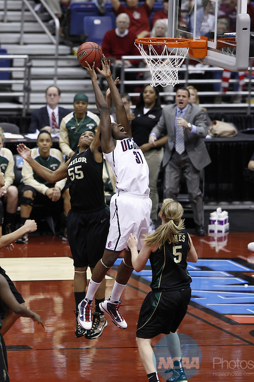 04 APR 2010:  University of Connecticut center Tina Charles (31) battles with Baylor University forward Morghan Medlock (55) for possession of a rebound during the Division I Women's Basketball Semifinals held at the Alamodome during the 2010 Women's Final Four in San Antonio, TX.  Connecticut defeated Baylor by a score of 70-50.   Trevor Brown, Jr./NCAA Photos