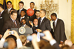 President Barack Obama plays with a signed basketball during the UK National Championship Celebration in the East Room of the White House, in Washington D.C., May 4, 2012. Photo by Brandon Goodwin | Staff