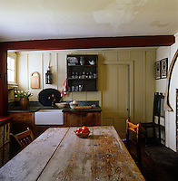 The wide plank walls of this kitchen are original to the house which was built in 1735 and the sink and stone counter are based on an English home of the period