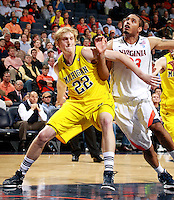 CHARLOTTESVILLE, VA- NOVEMBER 29: Blake McLimans #22 of the Michigan Wolverines looks for the rebound with Mike Scott #23 of the Virginia Cavaliers during the game on November 29, 2011 at the John Paul Jones Arena in Charlottesville, Virginia. Virginia defeated Michigan 70-58. (Photo by Andrew Shurtleff/Getty Images) *** Local Caption *** Blake McLimans;Mike Scott