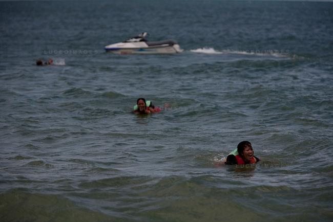 Vietnamese tourists get thrown from their jet ski on Mui Ne beach.