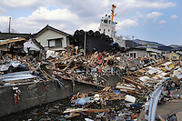 A ship left stranded near the city centre after being swept there by the water surge from a Tsunami. On 11 March 2011 a magnitude 9 earthquake struck 130 km off the coast of Northern Japan causing a massive Tsunami that swept across the coast of Northern Honshu. The earthquake and tsunami caused extensive damage and loss of life.