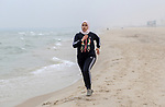 Dania El Masry, 20-years old a Paletinian woman from Khan younis student of Physical Therapy, runs on the beach as she plays CrossFit sport in the southern Gaza strip, on Feb. 07, 2017. CrossFit workouts incorporate elements from high-intensity interval training, Olympic weightlifting, plyometrics, powerlifting, gymnastics, girevoy sport, calisthenics, strongman, and other exercises. Photo by Mofeed Abo Zaida