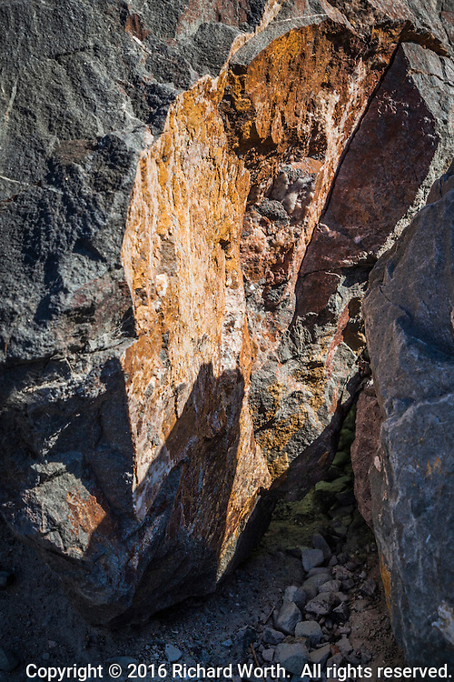 This could be a massive canyon towering over a dry riverbed, but it's not.  Large rocks, a foot or two high, along the shore of San Francisco Bay photographed in close-up.