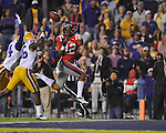 Ole Miss wide receiver Donte Moncrief (12) makes a touchdown catch against LSU cornerback Tharold Simon (24) and LSU safety Ronald Martin (26) at Tiger Stadium in Baton Rouge, La. on Saturday, November 17, 2012. LSU won 41-35.....