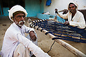 Gujarat men constructing bed, Dasada Gujarat, India --- Model Released