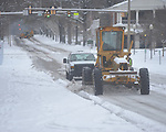 A city road grader clears snow on North Lamar in Oxford, Miss., on Monday, January 10, 2011.