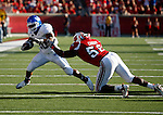 Running back Victor Anderson evades Antwone Canady in the second half of the UK's 23-16 win over U of L, kicking off Joker Phillip's reign as head coach on Saturday, September 5, 2010. Photo by Britney McIntosh | Staff