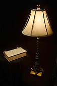 Antique lamp and old book stock photo