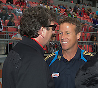15 September 2012: Toronto FC head coach Paul Mariner speaks with Philadelphia Union team manager Jack Hackworth during the opening ceremonies in an MLS game between the Philadelphia Union and Toronto FC at BMO Field in Toronto, Ontario..The game ended in a 1-1 draw..