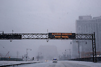 An electronic sign displays a blizzard warning along West Street during the pass of the winter storm JONAS, in New York, 01/23/2016. Photo by VIEWpress