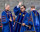 May 17, 2015; Alfredo Quiñones-Hinojosa waves to the crowd after University of Notre Dame President Rev. John Jenkins, C.S.C. (left) and Notre Dame Board of Trustees Chairman Richard Notebaert awarded him an honorary doctorate at the 2015 Commencement ceremony. (Photo by Barbara Johnston/University of Notre Dame)