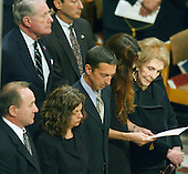 Former first lady Nancy Reagan, right, and her family at Ronald Reagan's funeral at the Washington National Cathedral in Washington, D.C. on June 11, 2004.   From left, Michael Reagan, Doria Reagan, Ron Reagan, Jr., Patty Davis, and Nancy Reagan.  The gentleman at the upper left is Doctor Richard Davis, Nancy Reagan's brother.