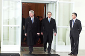 Washington, DC - January 20, 2001 -- United States President Bill Clinton walks out of the White House for the last time as president with President-elect George W. Bush as they departed for the United States Capitol and the swearing-in ceremony..Credit: Ron Sachs / CNP