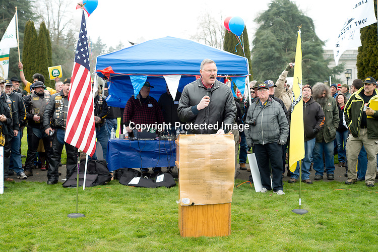 "Former NFL player Clint Didier addresses some of the 1,500 gun owners and enthusiasts attending the Guns Across America rally at the Washington State Capitol in Olympia Saturday, Jan. 19, 2013. Didier told the crowd they should bury food, resources, ham radios and everything you will need to survive independently in an uncertain future. ""This president is not my president,"" he said. The organization held events at capitol buildings in many states to show support for the 2nd Amendment and opposition to new gun control measures. Photo by Daniel Berman/www.bermanphotos.com"