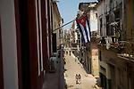 HAVANA, CUBA -- MARCH 25, 2015:   People walk through the Havana Vieja neighborhood in Havana, Cuba on March 25, 2015. Photograph by Michael Nagle