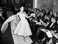 Sybil Connolly Fashion Show at New Premises at Merrion Sq..17/01/1958..Sybil Connolly (24 January 1921, Swansea, Wales - 6 May 1998, Dublin) was an Irish fashion designer for Brunschwig &amp; Fils, F. Schumacher &amp; Co., Tiffany &amp; Co., etc. She was named to the International Best Dressed List Hall of Fame in 1965..Sybil Connolly was born to a Welsh mother and an Irish father; they moved to County Waterford, where she was educated at a convent school run by the Sisters of Mercy. Her interest in fashion led her to London, aged 17, to study dressmaking with Bradley &amp; Co..Her clothes were sought after in the United States and she had an impressive list of clients from prominent families such as the Rockefellers, Mellons and Duponts, to famous actresses of the day. Jacqueline Kennedy wore a Sybil Connolly creation when she sat for her official White House portrait and visited the designer in Ireland. A showcase for her excellent taste in interior decoration, her home was featured in House Beautiful in 1967.[citation needed].In the 1980s, Sybil Connolly began designing for luxury goods makers Tiffany &amp; Co of New York, Tipperary Crystal, Brunschwig &amp; Fils, and Schumacher. Connolly lived at 71 Merrion Square in Dublin for many years and died there in May 1998. Considered one of Dublin's finest Georgian Squares, Merrion Square was first laid out in 1762 and mostly completed by the beginning of the 19th century. Now home to a number of prestigious organizations, including the Irish Red Cross, the National Gallery of Ireland and the National Museum of Ireland, the square was mainly residential up until the 1960s. The square boasted a number of notable residents during its history, including Oscar Wilde at No. 1, the poet William Butler Yeats at No. 82, and at No. 58, Daniel O'Connell, an Irish politician and campaigned for Catholic emancipation..She returned to Ireland at the outbreak of World War II and lived there for the rest of her life, making her home at number 71 Merrion