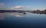 California, east central, Lee Vining. Cloud reflections in the calm waters of  Mono Lake in autumn.